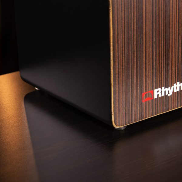 closeup of front right corner of Rhythm Tech cajon on wooden table