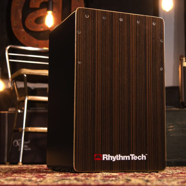 Rhythm Tech cajon in front of hanging light bulbs and metal chair