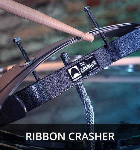 closeup of drumstick hitting Ribbon Crasher