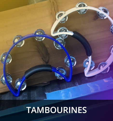 a blue and a white crescent-shaped tambourine