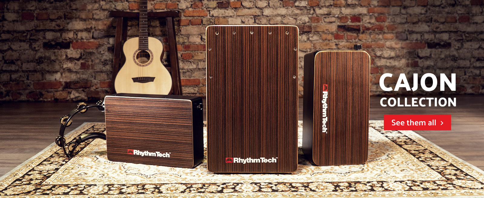Three Rhythm Tech cajons in front of brick wall